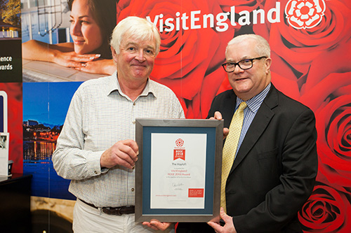 Richard receiving the Rose Award from the England Director of Visit England, Andrew Stokes at Olympia, October 2018